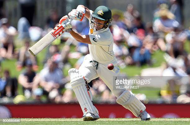 Australian batsman David Warner plays a shot against the West Indies on the first day of the first cricket Test match in Hobart on December 10 2015...