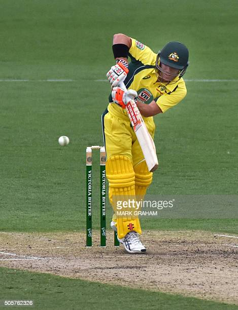 Australian batsman David Warner plays a shot during the fourth oneday international cricket match between India and Australia at the Manuka Oval in...