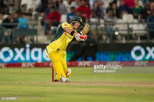 Australian batsman David Warner plays a shot during the third and final T20 cricket match between South Africa and Australia at the Newlands Stadium...