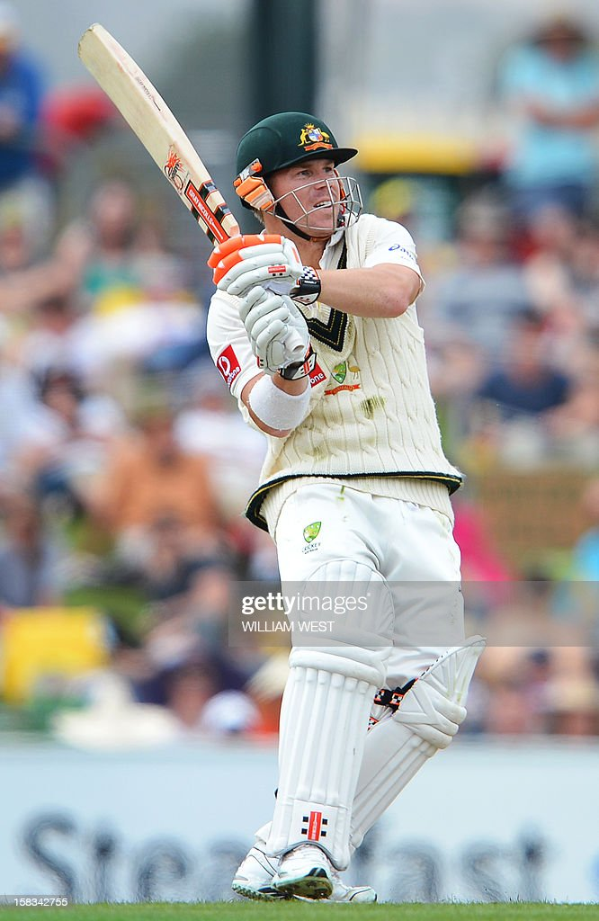 Australian batsman David Warner pulls a ball against Sri Lanka on the first day of the first cricket Test match in Hobart on December 14, 2012. AFP PHOTO/William WEST IMAGE