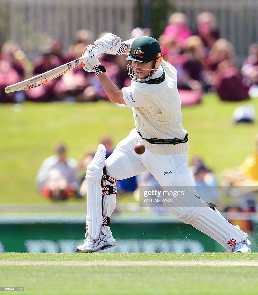 Australian batsman David Warner steers the ball away from the Sri Lankan bowling on the fourth day of the first cricket Test match, in Hobart on December 17, 2012. AFP PHOTO/William WEST IMAGE
