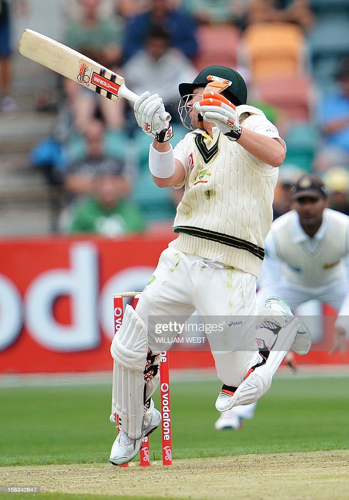 Australian batsman David Warner takes evasive action from a Sri Lankan bouncer on the first day of the first cricket Test match, in Hobart on December 14, 2012. AFP PHOTO/William WEST IMAGE