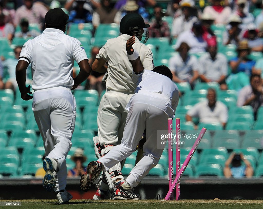 Australian batsman Ed Cowan (C) is run out on day two of the third cricket Test between Sri Lanka and Australia at the Sydney Cricket Ground on January 4, 2013. IMAGE STRICTLY RESTRICTED TO EDITORIAL USE - STRICTLY NO COMMERCIAL USE AFP PHOTO / Greg WOOD