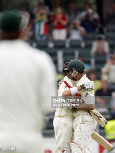 Australian batsman Marcus North and Mitchell Johnson embraceas they celebrate North's century on February 27 2009 during the second day of the first...