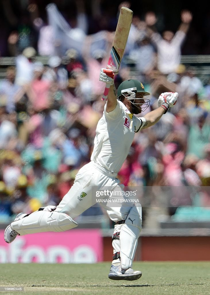 Australian batsman Matthew Wade celebrates after scoring his century (100 runs) on day three of the third cricket test match between Australia and Sri Lanka at the Sydney Cricket Ground on January 5, 2013. AFP PHOTO/ MANAN VATSYAYANA USE
