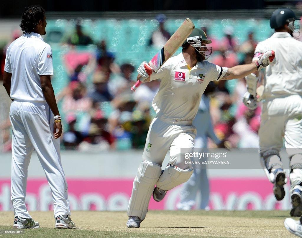Australian batsman Matthew Wade (C) celebrates after scoring his century (100 runs) on day three of the Third cricket Test between Australia and Sri Lanka at the Sydney Cricket Ground on January 5, 2013.