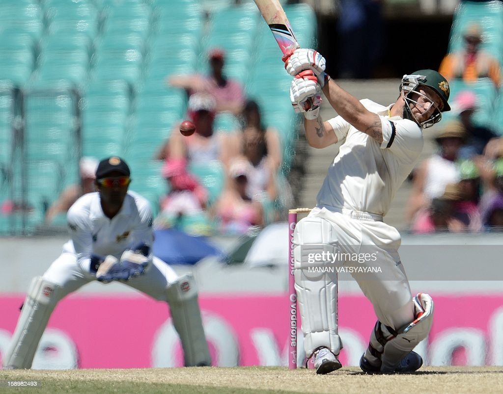 Australian batsman Matthew Wade (R) plays a shot on way to his century (100 runs) on day three of the third cricket Test between Australia and Sri Lanka at the Sydney Cricket Ground on January 5, 2013.