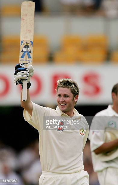Australian batsman Michael Clark acknowledges the applause after scoring his century against New Zealand on the third day of the first Test being...