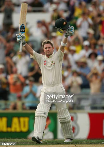 Australian batsman Michael Clarke celebrates reaching his century during his innings of 135 not out on day three of the 3rd Test match between...