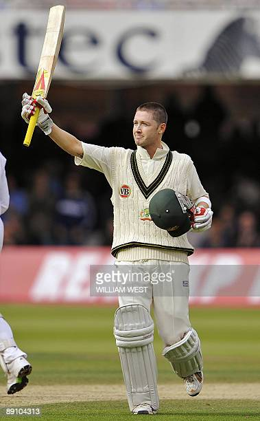 Australian batsman Michael Clarke celebrates scoring his century against England on the fourth day of the second Test match at Lords on July 19 in...