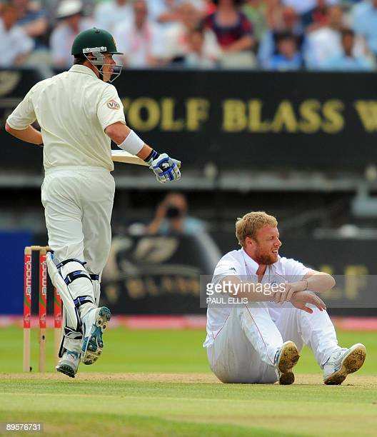 Australian batsman Michael Clarke looks down as England bowler Andrew Flintoff falls to the ground while bowling on the final day of the third Ashes...