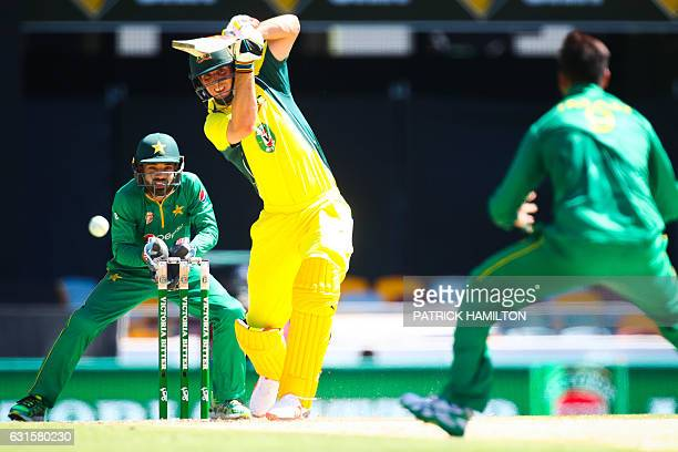Australian batsman Mitchell Marsh drives for four runs during the oneday international cricket match between Pakistan and Australia in Brisbane on...