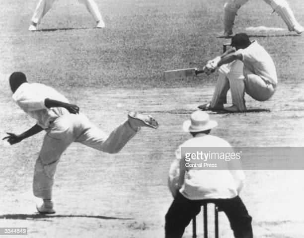 Australian batsman Norman O'Neill crouches to avoid a fast ball from West Indies bowler Wesley Hall during the second innings of the first test at...