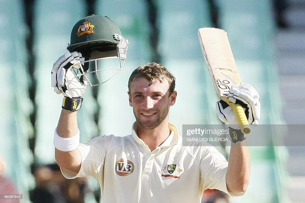 Australian batsman Phillip Hughes raises his bat and helmet as he celebrates after scoring his century, the second one of the Test, on March 8, 2009 during the third day of the second Test match between South Africa and Australia at Kingsmead stadium in Durban, South Africa. Hughes is the youngest batsman to have scored two centuries in the same test match.