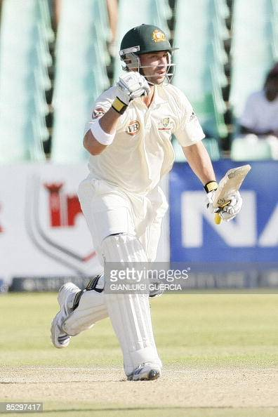 Australian batsman Phillip Hughes raises his fist as he celebrates scoring his century the second one of the Test on March 8 2009 during the third...