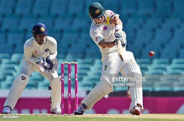 Australian batsman Shane Watson pulls a delivery away in front of Indian wicketkeeper Wriddhiman Saha on the first day of the fourth cricket Test at...