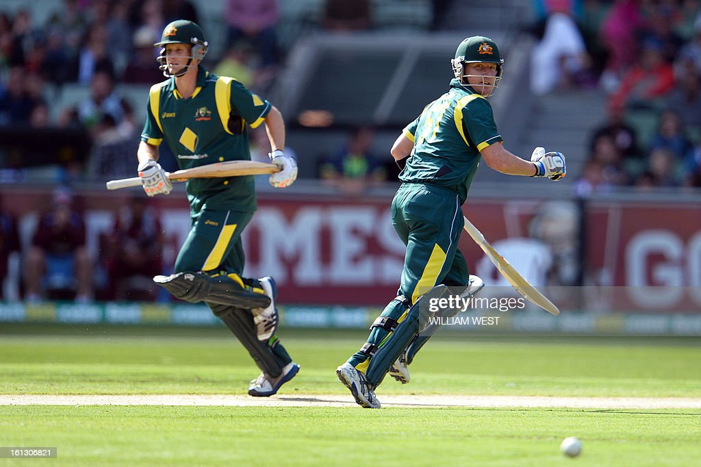 Australian batsmen Adam Voges (L) and Brad Haddin (R) take more runs from the West Indies bowling in their one-day cricket international played at the Melbourne Cricket Ground (MCG), on February 10, 2013. AFP PHOTO/William WEST IMAGE