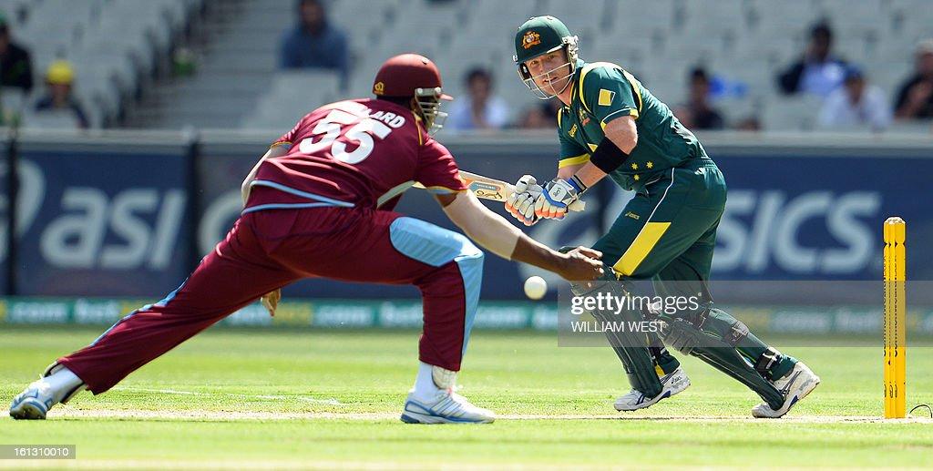 Australian batsmen Brad Haddin (R) steers a ball past West Indies fielder Kieron Pollard (L) in their one-day cricket international played at the Melbourne Cricket Ground (MCG), on February 10, 2013. AFP PHOTO/William WEST IMAGE