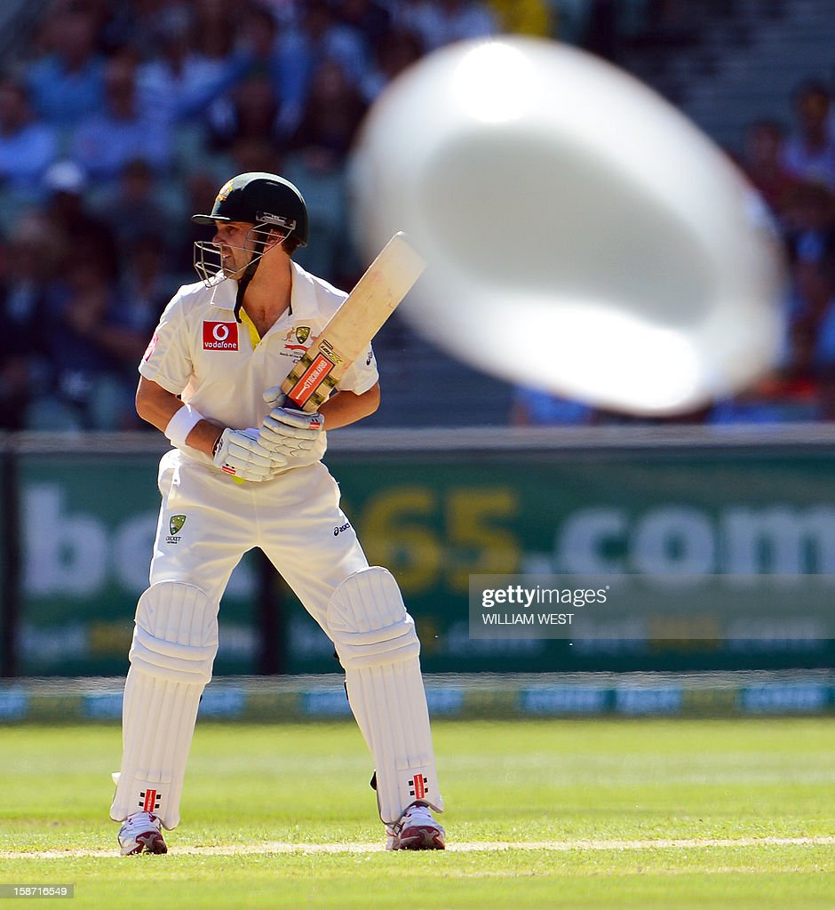 Australian batsmen Ed Cowan prepares to receive a delivery from the Sri Lankan bowling as a balloon drifts across the field on the first day of the second cricket Test match at the Melbourne Cricket Ground (MCG), in Melbourne, on December 26, 2012. AFP PHOTO/William WEST IMAGE