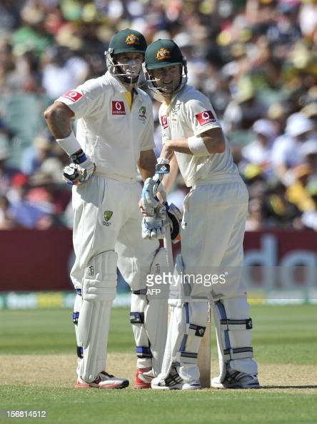 Australian batsmen Michael Clarke and Mike Hussey discuss tactics in between overs batting against South Africa on the first day of the second...