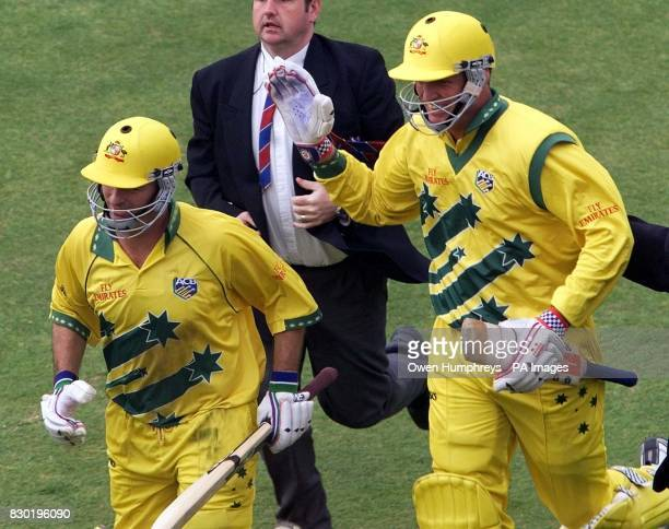 Australian batsmen Steve Waugh and Tom Moody run off to celebrate their win over South Africa in their Cricket World Cup Super Six match at...