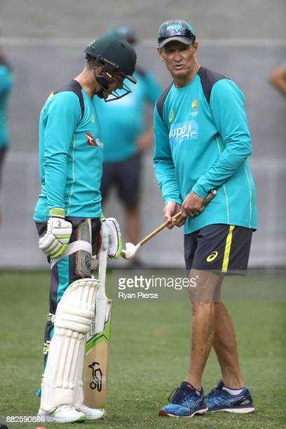 Australian Batting Coach Graeme Hick speaks to Tim Paine of Australia during an Australian nets session at Adelaide Oval on November 30 2017 in...