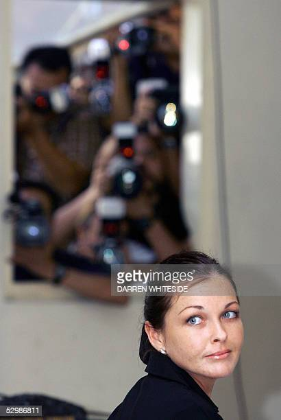 Australian beauty therapist Schapelle Corby looks back at her family during her trial in a Denpasar court on the Indonesian resort island of Bali 27...