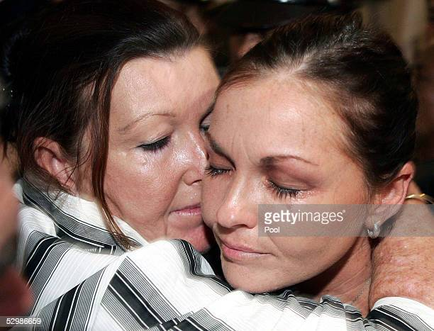 Australian beauty therapist Schapelle Corby receives a kiss from her mother Roseleigh Rose in court after she was found guilty of trying to smuggle...