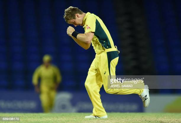 Australian bowler Adam Zampa celebrates after dismissing South African cricketer Wayne Parnell during their Trination series One Day International...