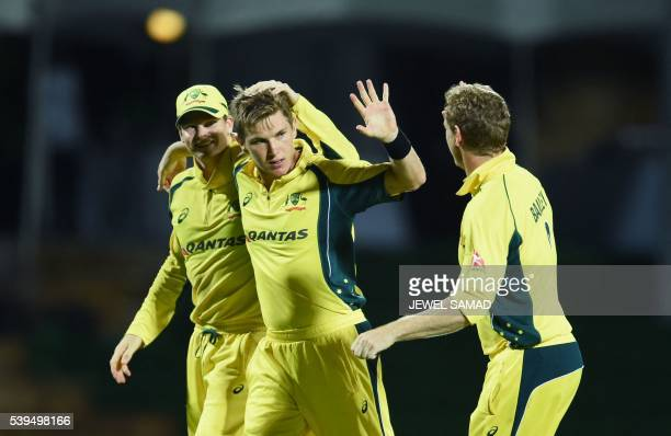 Australian bowler Adam Zampa celebrates with teammates after dismissing South African cricketer Wayne Parnell during their Trination series One Day...