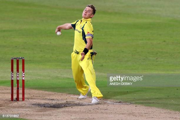 Australian bowler Adam Zampa delivers a ball during the first T20 cricket match against South Africa at Kingsmead stadium on March 4 2016 in Durban...