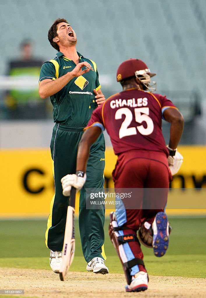 Australian bowler Ben Cutting (L) reacts as West Indies batsman Johnson Charles (R) has a lucky escape in their one-day cricket international played at the Melbourne Cricket Ground (MCG), on February 10, 2013. AFP PHOTO/William WEST IMAGE