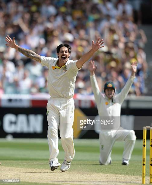 Australian bowler Mitchell Johnson screams out an appeal on the third day of the fourth Ashes cricket Test match against Australia in Melbourne on...
