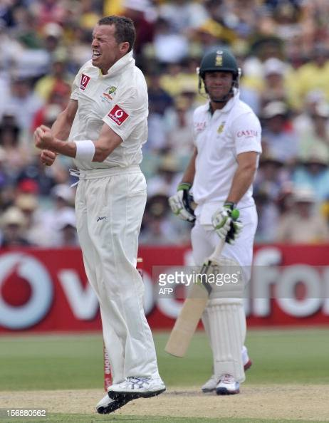 Australian bowler Peter Siddle celebrates the dismissal of South African batsman Abraham de Villiers on the third day of the second cricket test...
