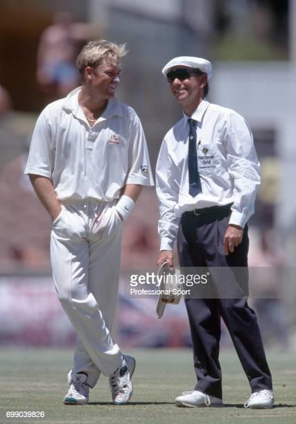 Australian bowler Shane Warne talking to umpire Karl Liebenberg during the 5th Test match between Australia and England at the WACA Perth Australia...