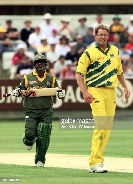 Australian bowler Tom Moody who is 6 feet seven inches tall towers over Bangladesh Captain Aminul Islam during their Cricket World Cup Match at...