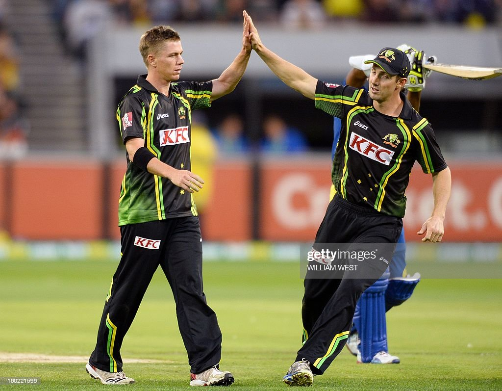 Australian bowler Xavier Doherty (L) is congratulated by teammate Shaun Marsh (R) after dismissing Sri Lankan batsman Jeevan Mendis during their Twenty20 match played at the Melbourne Cricket Ground (MCG), on January 28, 2013. AFP PHOTO/William WEST USE