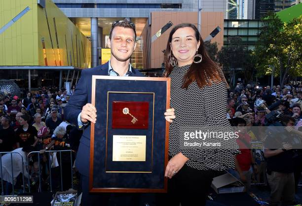 Australian boxer Jeff Horn holds the keys to the city with his wife Jo Horn during a ticker tape parade on July 6 2017 in Brisbane Australia Horn...