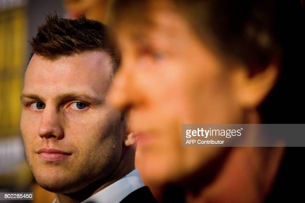 Australian boxer Jeff Horn looks at trainer Glenn Rushton during a press conference to promote Horn's upcoming WBO welterweight boxing title fight...