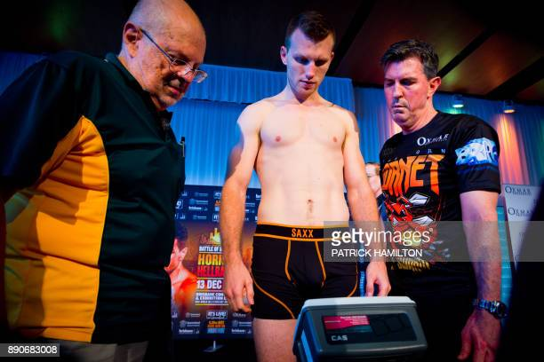 Australian boxer Jeff Horn looks on during the prefight weighin at the Brisbane Convention Centre in Brisbane on December 12 the eve of the World...