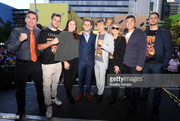 Australian boxer Jeff Horn poses for a photo with his wife Jo Horn trainers Glenn Rushton and Dundee Kim and his training team during a ticker tape...