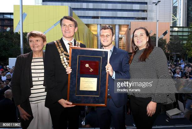 Australian boxer Jeff Horn poses for a photo with the keys to the city alongside his wife Jo Horn and Brisbane Lord Mayor Graham Quirk during a...