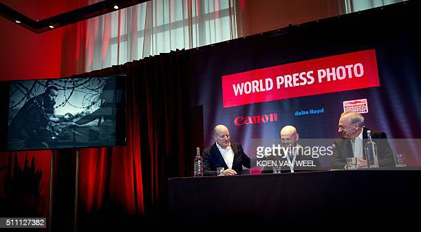 Australian Budapestbased freelance photographer Warren Richardson flanked by the managing Director of the World Press Photo Foundation Lars Boering...