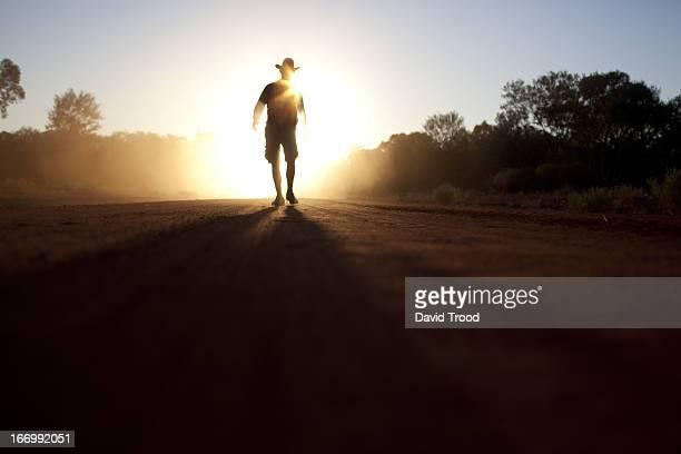 Australian bush man walking in the dust