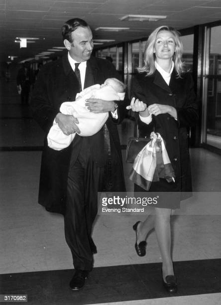 Australian businessman and media tycoon Rupert Murdoch with his wife Anna and their baby daughter Elizabeth at London Airport