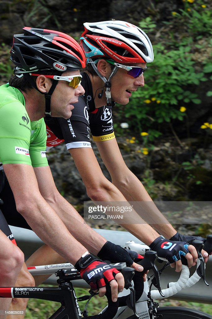 Australian Cadel Evans (L) and Andy Schleck from Luxembourg (R) ride during the third stage of the 64th edition of the Dauphine Criterium cycling race run between Givors and La Clayette, Southeastern France, on June 06, 2012.
