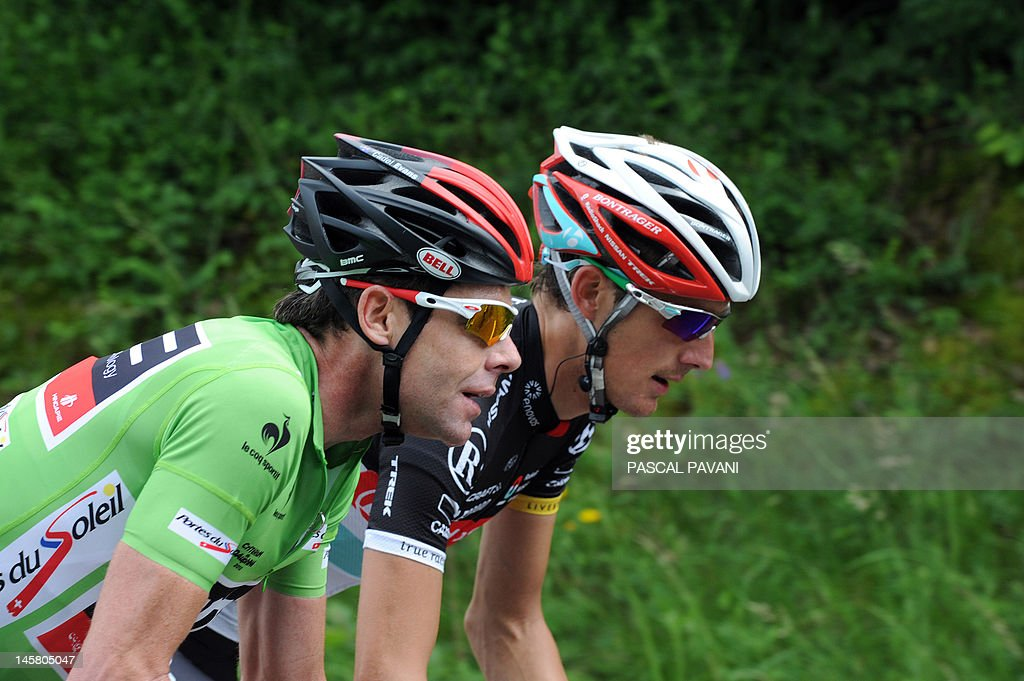 Australian Cadel Evans (L) and Andy Schleck from Luxembourg (R) ride during the third stage of the 64th edition of the Dauphine Criterium cycling race run between Givors and La Clayette, Southeastern France, on June 06, 2012. AFP PHOTO / PASCAL PAVANI