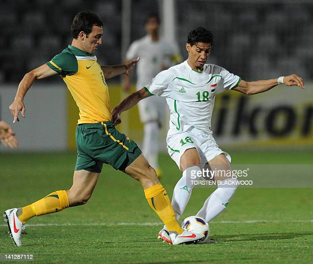 Australian captain Ben Kantarovski clashes with Iraq's Ammar Ahmed in Gosford on March 14 2012 during the AFC Asian qualifier for the 2012 London...