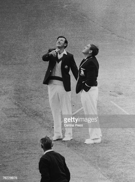 Australian captain Bill Lawry and his English counterpart Ray Illingworth toss for the Third Test match in Melbourne 6th January 1971 The game was...