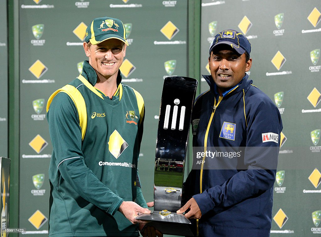 Australian captain George Bailey and Sri Lankan captain Mahela Jayawardene share the Commonwealth Bank trophy after the series of five One Day International matches ended in a draw, at Blundstone Arena in Hobart on January 23, 2013.